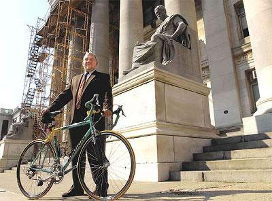 New Haven public defender Michael Alevy of New Haven will be riding in the Pan-Massachusetts Challenge, a 196-mile bike ride to raise funds for the Dana-Farber Cancer Institute, and in memory of his friend, who died of melanoma. (Mara Lavitt/Register)