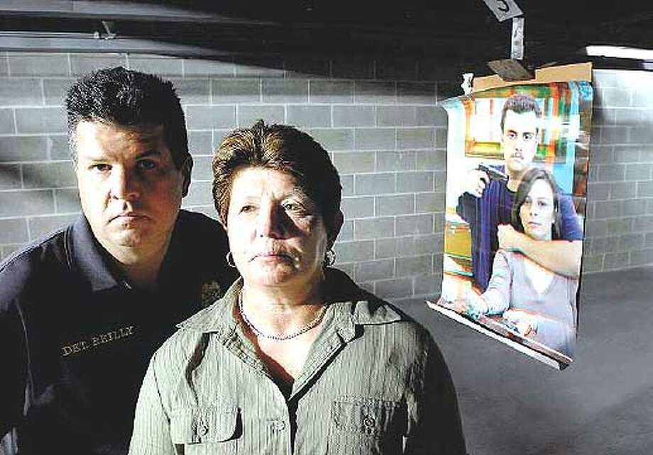 From left, Detectives Brian Reilly and Mary Canfield of the West Haven Police Department's Domestic Violence Unit. (Arnold Gold/Register)