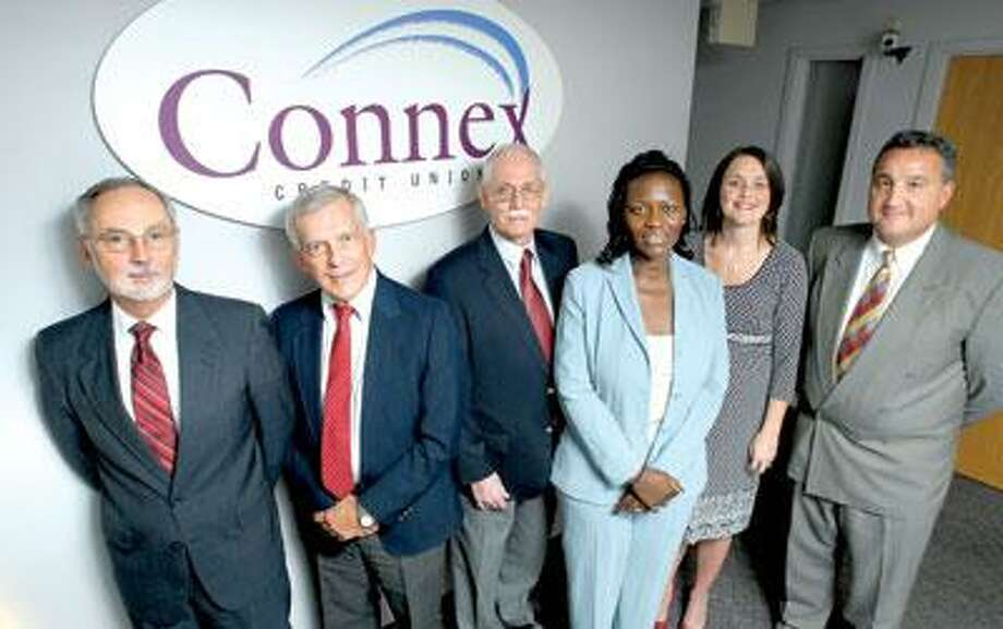 The leadership team of Connex gathers at the company's North Haven headquarters, from left to right: President and CEO John Edwards, Chairman Fred Heimann, Vice President of Lending Dick Boyd, Vice President of Human Resources Michelle Silva, Vice President of Sales and Service Tansley Stearns, and Vice President of Finance and Chief Financial Officer Frank Mancini. (Arnold Gold/Register)