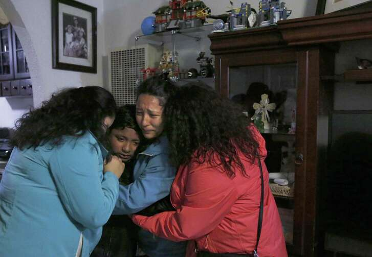 Jesus Sanchez, 12, gets a group hug from his sisters, from left, Elizabeth, 16, Melin, 21, and Vianney, 23, before the leaving for the airport to send Jesus and their parents to Mexico August 16, 2017 in the Sanchez home in Oakland, Calif. The family's application for a stay was denied.