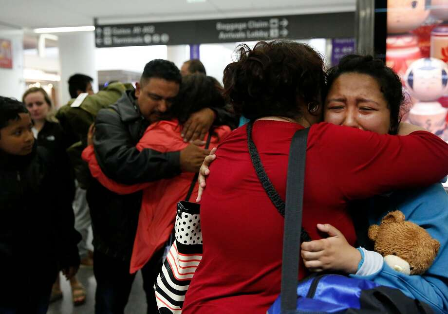 Maria Mendoza-Sanchez hugs her daughter Melin, 21, (right) as her husband, Eusebio, hugs daughter Vianney, 23, goodbye before the parents head to their flight to Mexico. Son Jesus is at left. Photo: Leah Millis, The Chronicle