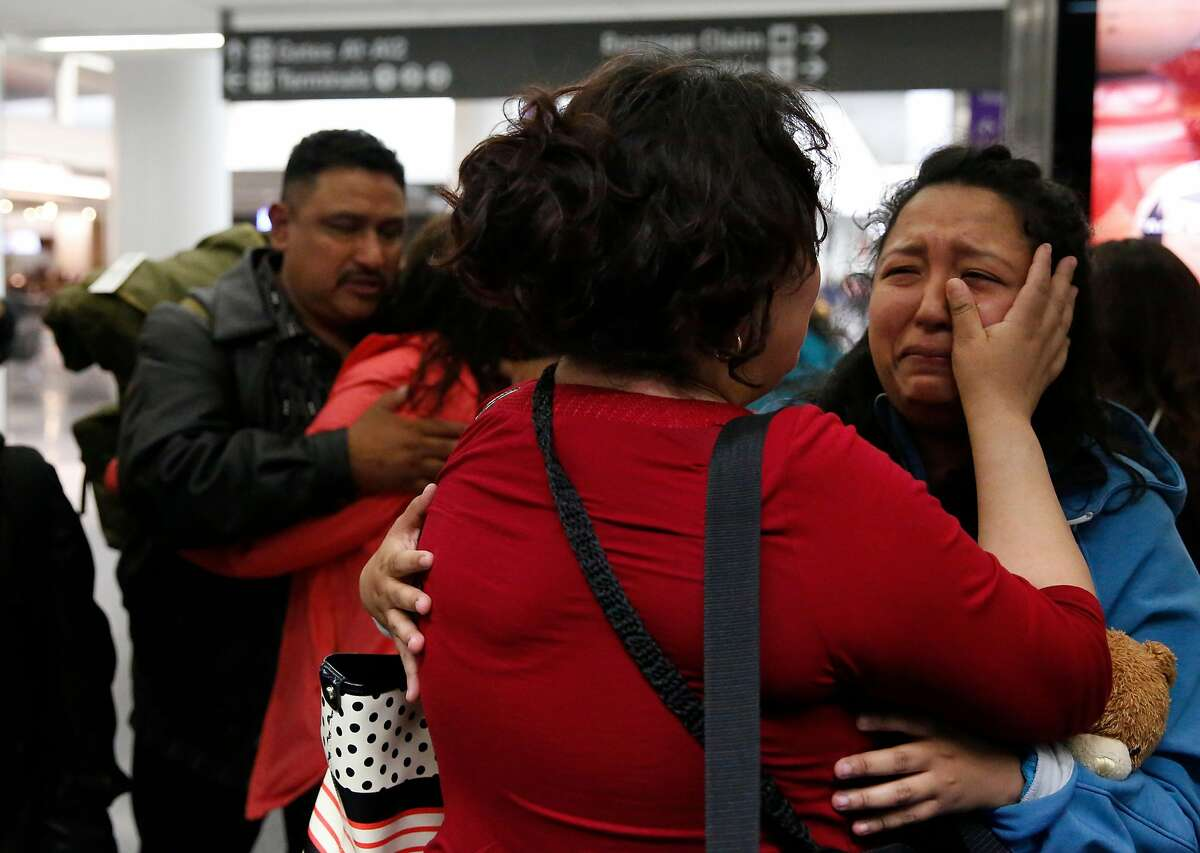 Maria Mendoza-Sanchez wipes the tears from the eyes of her daughter Melin, 21, as her husband Eusebio hugs one of their other daughters Vianney, 23, good bye as they leave for their flight back to Mexico from San Francisco International Airport August 16, 2017 in San Francisco, Calif. The family's application for a stay was denied.