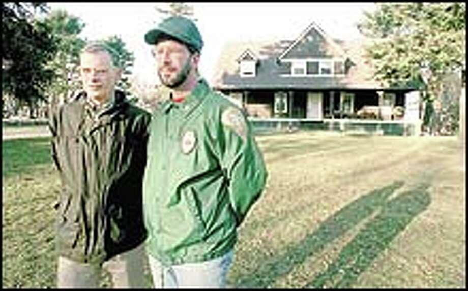 Bob Gordon (left) , president of the Guilford Preservation Alliance, and Mike McBride, Museum Curator of the Henry Whitfield State Museum,  stand on the former Woodruff estate that they hope to keep out of developers hands.Photo by Arnold Gold3/24/2000