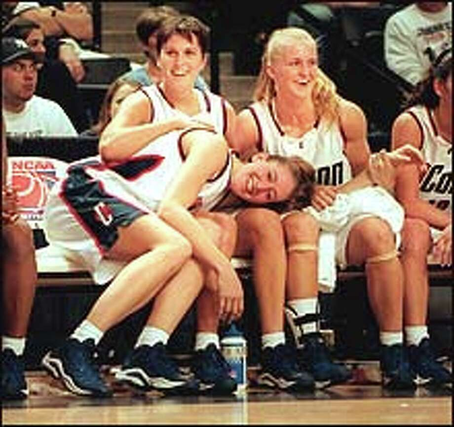03/25/2000 Richmond, Va. (Jeff Holt/photo) - University of Connecticut's Svetlana Abrosimova, Shea Ralph and Kelly Schumacher enjoy the final minute of the game vs OU as they had a resounding win.