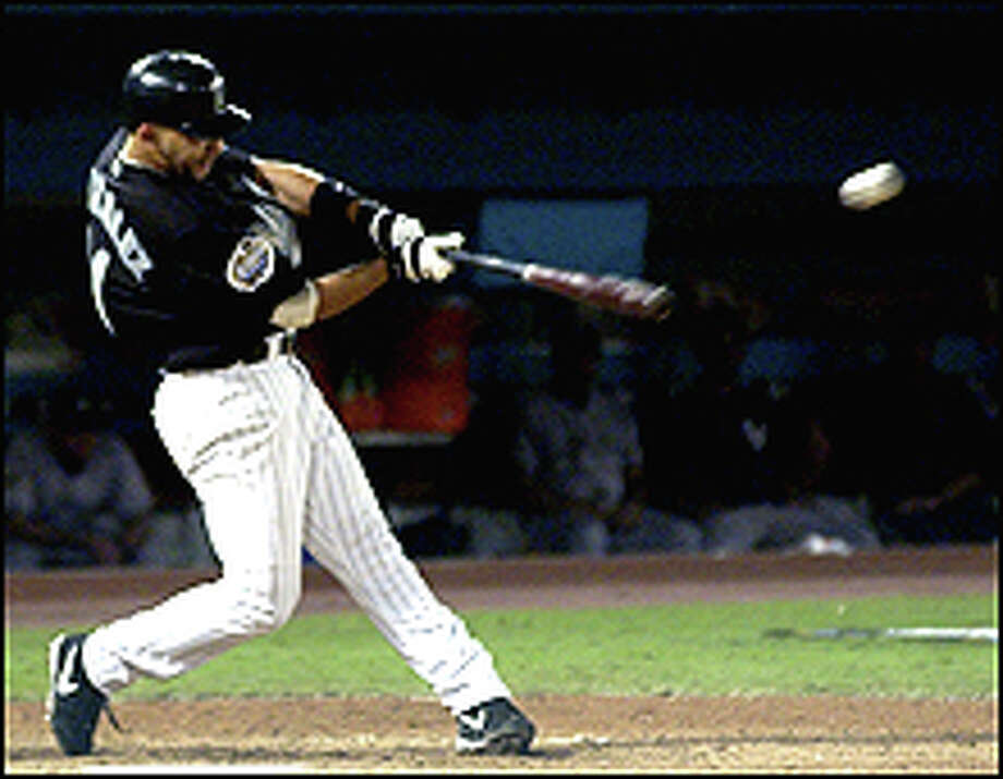 Florida Marlins' Alex Gonzalez hits a home run in the 12th inning to beat the New York Yankees 4-3 in game 4 of the World Series at Pro Player Stadium in Miami, Fla., Wednesday Oct. 22, 2003. (AP Photo/David Phillip) Photo: AP / AP