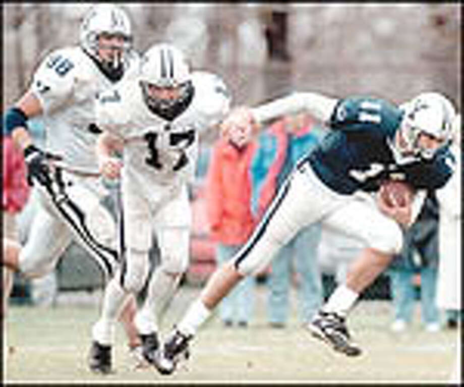 West Haven, CT. #11, Quarterback, Peter Lee, makes a play,  as #98-Nick ?(check last name) and #17-Todd Torrich? (check last name) try to stop him during the Yale football scrimage on Saturday afternoon. photo by Kristen E. Somody 4/22/00