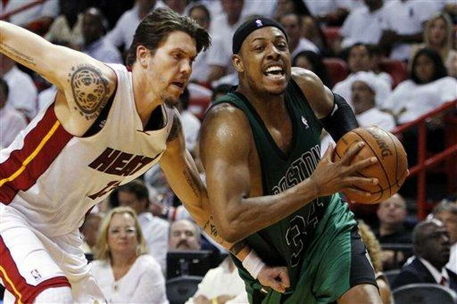 Boston Celtics' Paul Pierce (34) drives to the basket as Miami Heat's Mike Miller (13) defends during the second half of Game 2 in their NBA basketball Eastern Conference finals playoffs series, Wednesday, May 30, 2012, in Miami. (AP Photo/Lynne Sladky) Photo: AP / AP