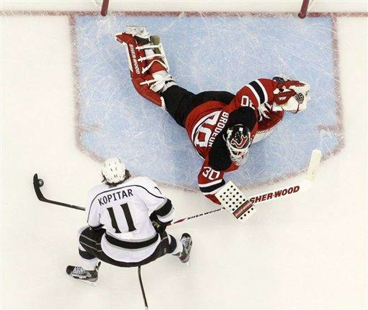 Los Angeles Kings' Anze Kopitar, of Slovenia, prepares to shoot the puck past New Jersey Devils' Martin Brodeur for a goal during overtime in Game 1 of the NHL hockey Stanley Cup finals Wednesday, May 30, 2012, in Newark, N.J. The Kings won 2-1. (AP Photo/Julio Cortez)