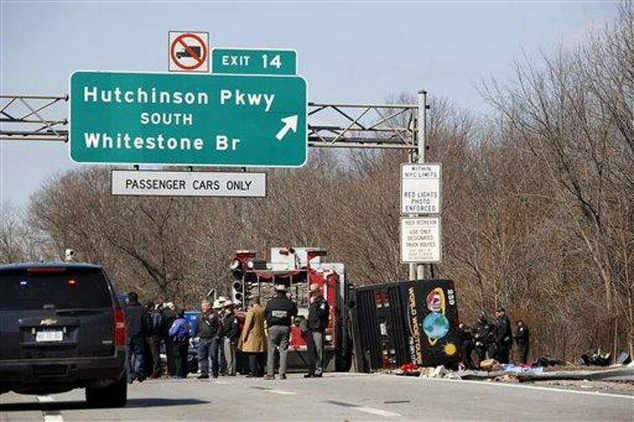 Emergency personnel investigate the scene of a bus crash on I-95 in the Bronx borough of New York in March 2011. Twenty-six bus operations that transported more than 1,800 passengers a day along I-95 between New York and Florida have been closed for safety violations in what federal officials say is the government's largest single safety crackdown of the motor coach industry in at least a decade. Associated Press Photo: AP / FR50733 AP