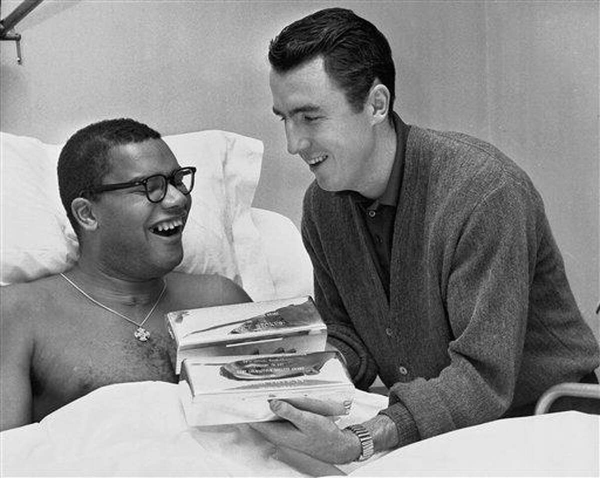 In this 1962 file photo, Jack Twyman, right, holds the trophies he and Maurice Stokes received from the Philadelphia Sports Writers Association designating them as the