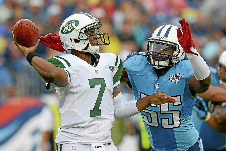 Titans linebacker Zach Brown (55) pressures New York Jets quarterback Geno Smith (7) in the third quarter Sunday. Photo: Mark Zaleski — The Associated Press  / FR170793 AP