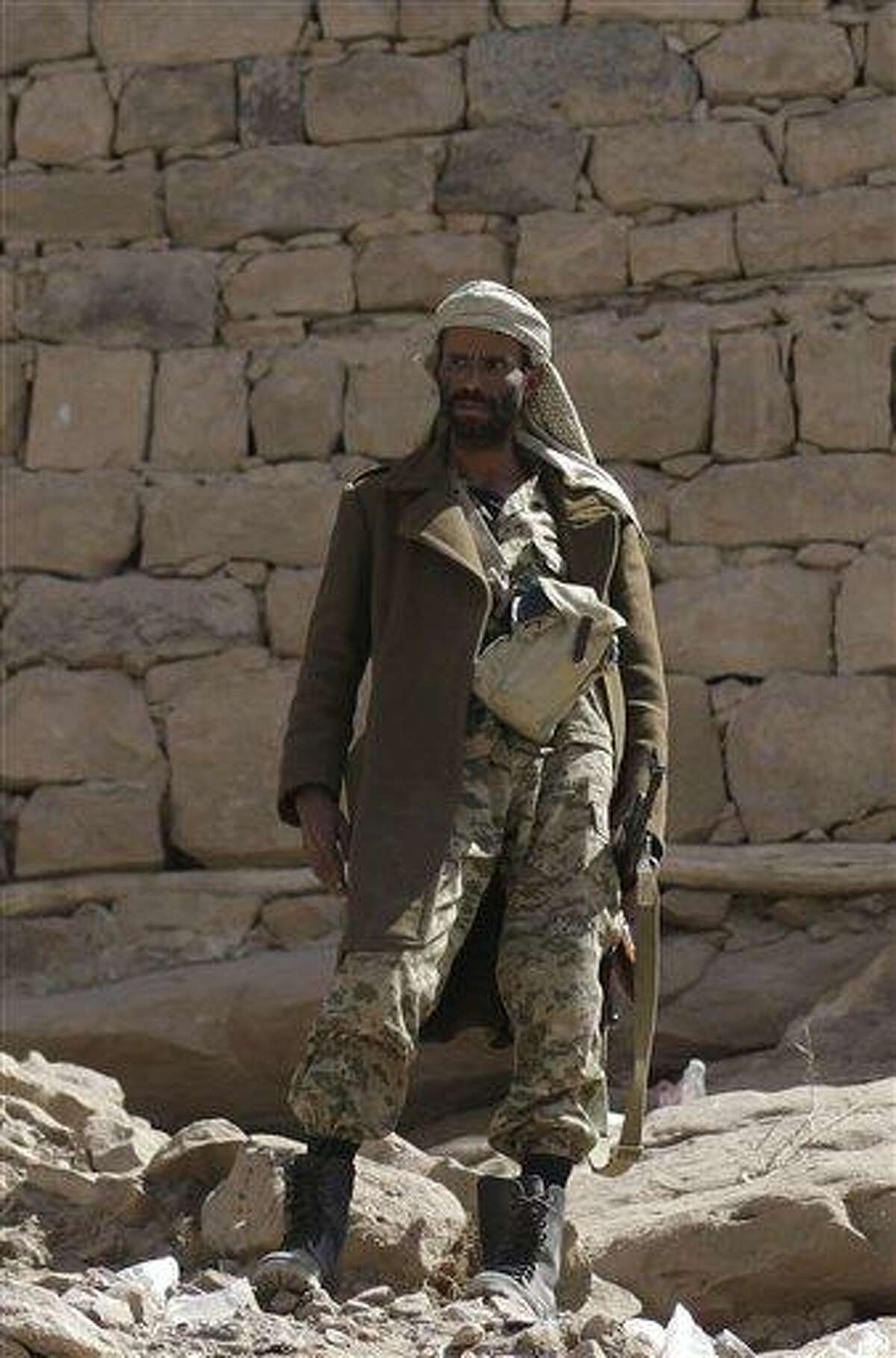A soldier stands guard outside of Radda Castle, which was recently seized by al-Qaida militants in the town of Radda, 100 miles (160 kilometers) south of the capital, Sanaa, Yemen. A tribal leader involved in negotiating with the militants said al-Qaida militants had withdrawn from Radda, leaving the town in the control of two prominent sheiks. Associated Press