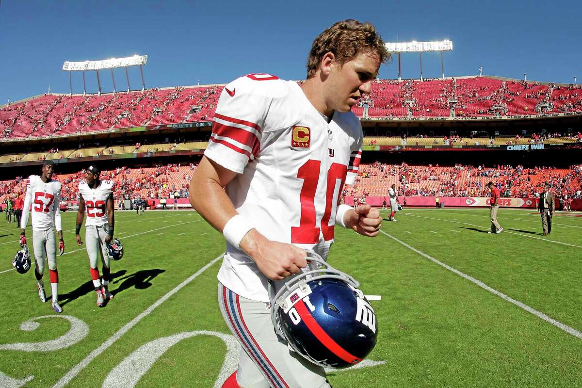 Giants quarterback Eli Manning walks off the field after Sunday's loss to the Kansas City Chiefs.