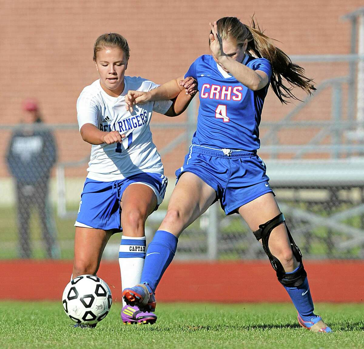 East Hampton captain Madison Germain battles Coginchaug's Alison Luther Monday afternoon in East Hampton. The Bellringers won 2-1 and remain undefeated leaving the Blue Devils with their first loss of the season.