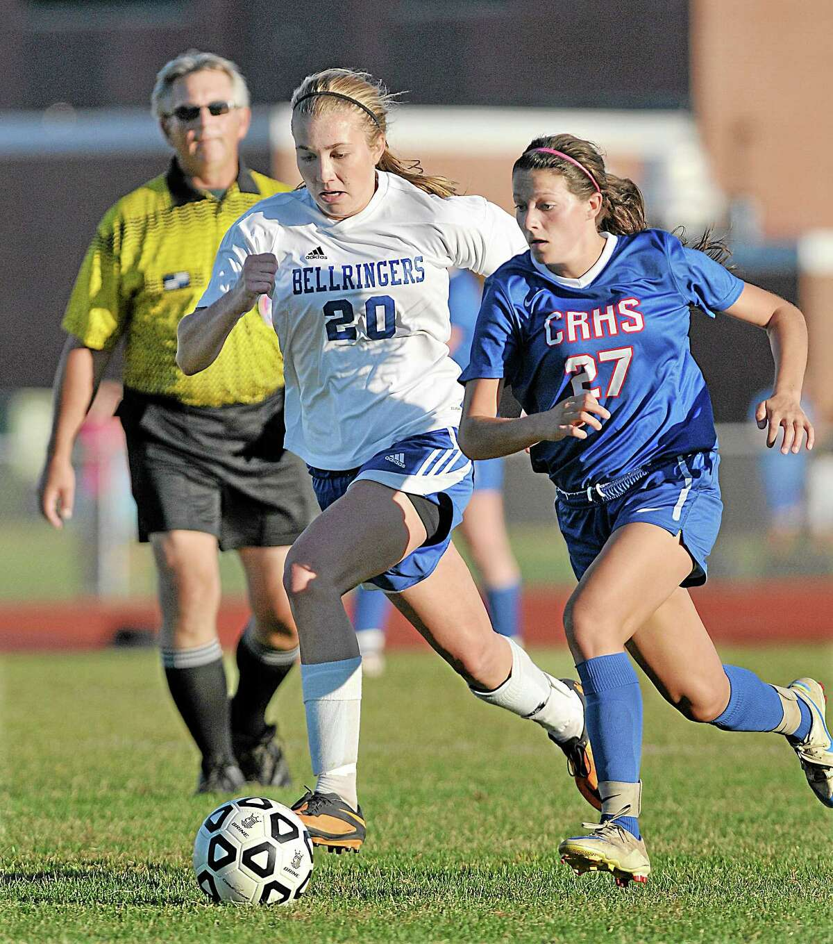 East Hampton's Meghan Orbann defends Coginchaug's Victoria Buonanni Monday afternoon in the Shoreline Conference game. The Bellringers defeated the Blue Devils 2-1 at home.