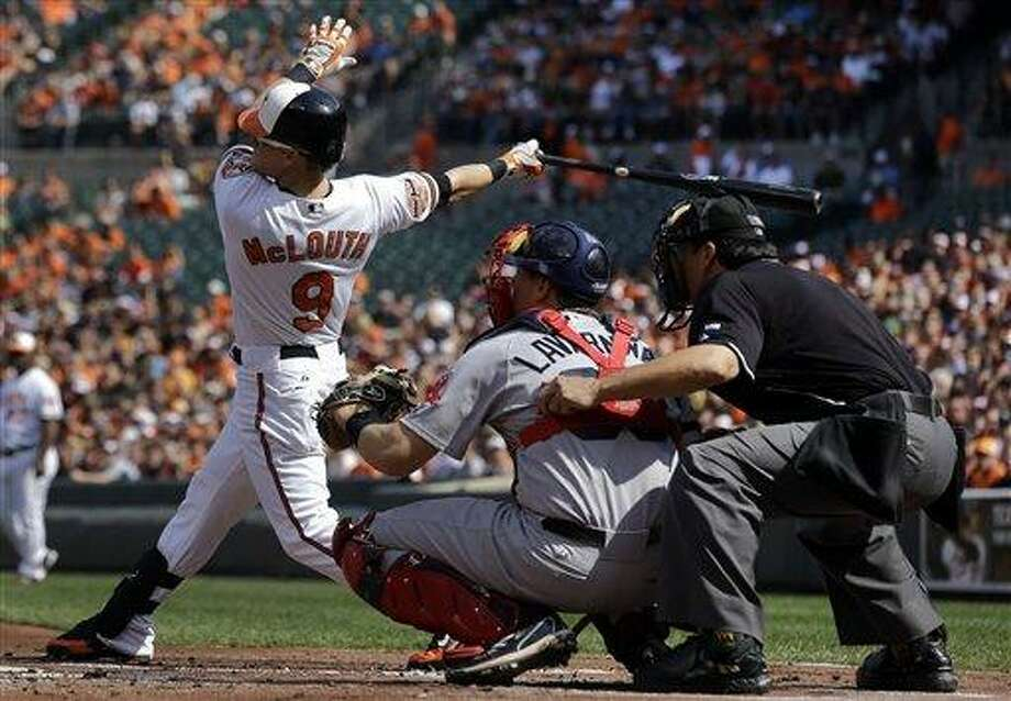 Baltimore Orioles' Nate McLouth, left, watches his solo home run in the first inning of a baseball game against the Boston Red Sox in Baltimore, Sunday, Sept. 30, 2012. (AP Photo/Patrick Semansky) Photo: AP / AP