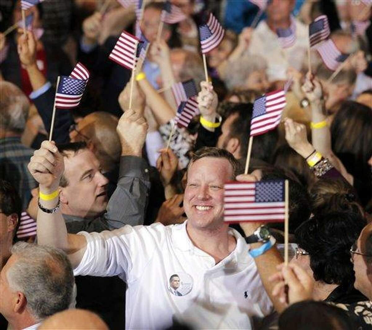 Supporters of Republican presidential candidate, former Massachusetts Gov. Mitt Romney, cheer the closing of the polls at his Florida primary primary night rally in Tampa, Fla., Tuesday, Jan. 31, 2012. (AP Photo/Gerald Herbert)