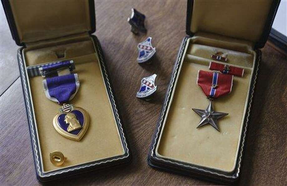 This July photo from New Britain, Conn., shows the Purple Heart and Bronze Star that were posthumously awarded to Cpl. Nicholas DeSimone, Jr., who went missing while serving in Korea on July 13, 1953. While helping her father organize his New Britain home,  Lana Ogrodnik of Waterbury, Conn., found a stack of letters from Nicholas. (AP Photo/Jim Shannon Republican-American) Photo: AP / Republican-American