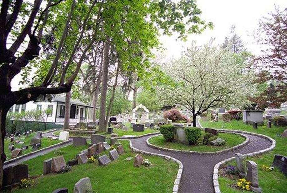 """This 2011 photo provided by the Hartsdale Pet Cemetery in Whtie Plains, N.Y., shows a scenic view of the first burial ground for animals named to the National Register of Historic Places. The 116-year-old Hartsdale Pet Cemetery, final home to some 75,000 animals and a few hundred humans, is being designated for its """"social history and landscape architecture."""" (AP Photo/Hartsdale Pet Cemetery, Mary Thurston) Photo: AP / Hartsdale Pet Cemetery"""