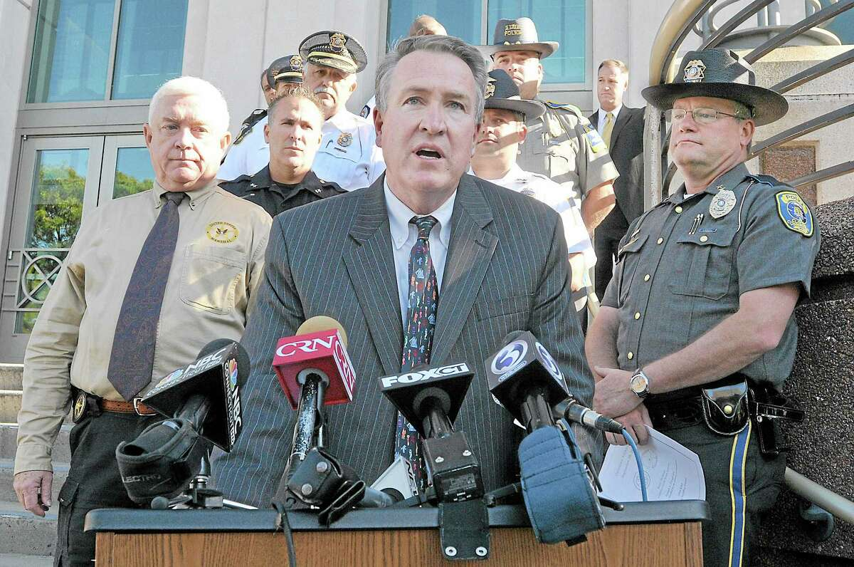 """""""When law enforcement works together, great things happen,"""" said Middlesex County state's attorney Peter McShane on the steps of Middlesex Superior Court on Court Street in Middletown. As part of """"Operation Archangel"""" officers from multiple Middlesex County police departments worked with agencies including the Connecticut and U.S. Marshals Service, the Department of Homeland Security and the Division of Immigration and Customs Enforcement to arrest nearly 60 individuals early Monday morning. Catherine Avalone - The Middletown Press"""