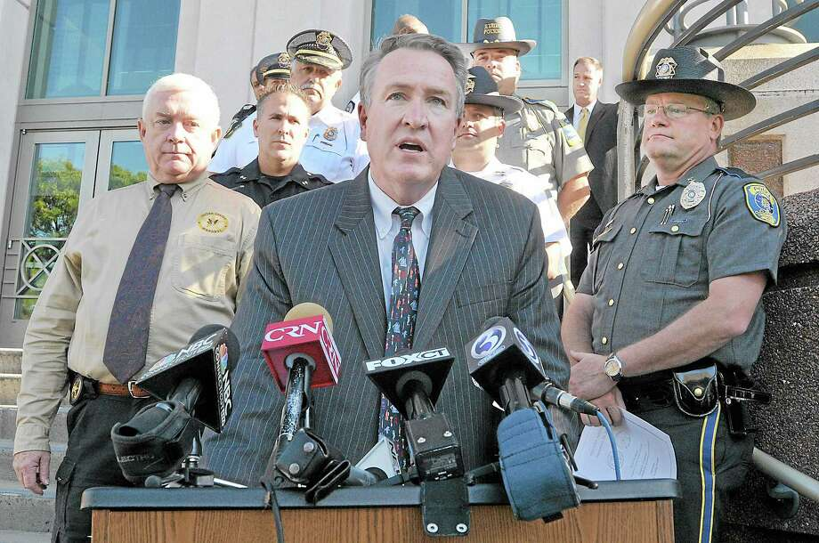 """""""When law enforcement works together, great things happen,"""" said Middlesex County state's attorney Peter McShane on the steps of Middlesex Superior Court on Court Street in Middletown. As part of """"Operation Archangel"""" officers from multiple Middlesex County police departments worked with agencies including the Connecticut and U.S. Marshals Service, the Department of Homeland Security and the Division of Immigration and Customs Enforcement to arrest nearly 60 individuals early Monday morning. Catherine Avalone - The Middletown Press Photo: Journal Register Co. / TheMiddletownPress"""