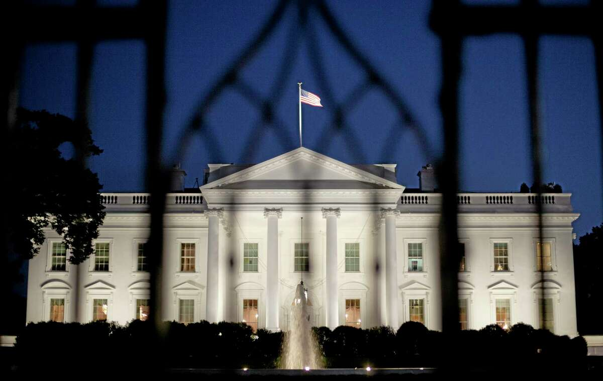 The White House in Washington is seen at night, Monday, Sept. 30, 2013. President Obama is ramping up pressure on Republicans to avoid a post-midnight government shutdown, saying a shutdown would hurt the economy and hundreds of thousands of government workers. (AP Photo/Pablo Martinez Monsivais)