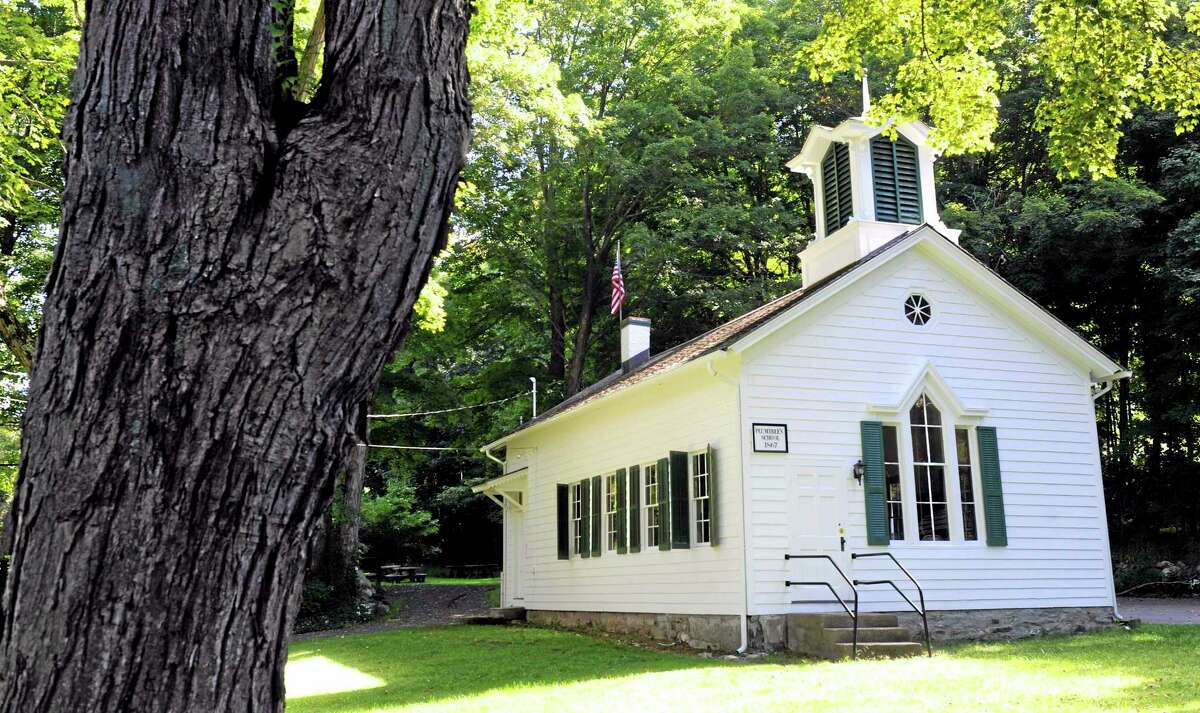 In this Sept. 4, 2013 photo the Plumtrees Schoolhouse rests under the shade of trees in Bethel, Conn.