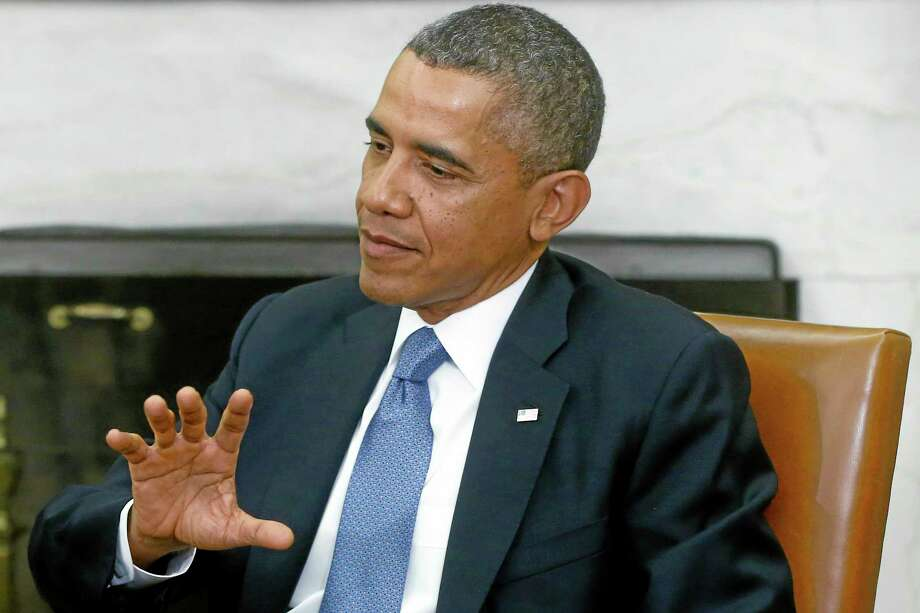 President Barack Obama answers a question about the looming federal government shutdown from a reporter during his meeting with Israeli Prime Minister Benjamin Netanyahu in the Oval Office of the White House in Washington, Monday, Sept. 30, 2013. (AP Photo/Charles Dharapak) Photo: AP / AP