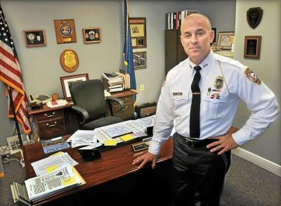File photo of East Hampton Police Chief Matthew A. Reimondo in his office. Catherine Avalone / TheMiddletownPress