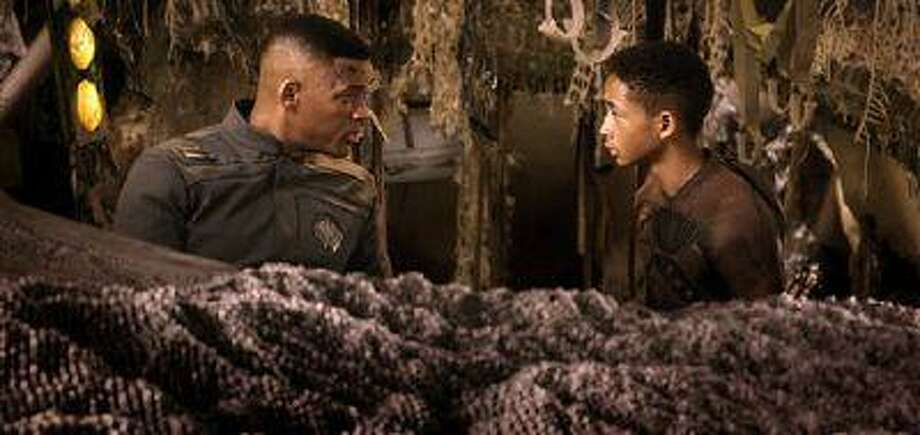 "This film publicity image released by Sony - Columbia Pictures shows Will Smith, left, and Jaden Smith in a scene from ""After Earth."" (AP Photo/Sony, Columbia Pictures) Photo: AP / Sony - Columbia Pictures"
