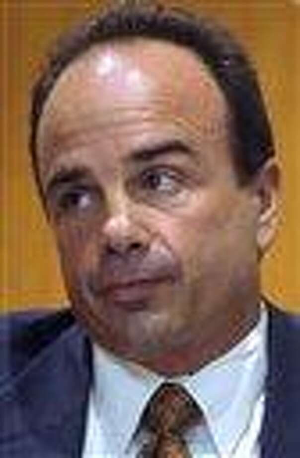 FILE - In this Sept. 11, 2012 photo, former Bridgeport Mayor Joseph Ganim appears before a three judge panel in Superior Court, in Bridgeport, Conn., in an effort to regain his law license. The panel rejected his request on Thursday, Sept. 27, 2012. Ganim was convicted in 2003 of federal corruption, and served seven years of a nine year sentence.  (AP Photo/Connecticut Post, Ned Gerard, File) Photo: AP / Connecticut Post
