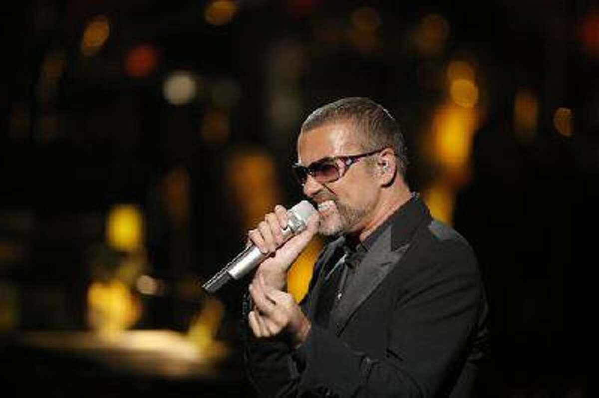 FILE - In this Sept. 9, 2012 file photo, British singer George Michael performs at a concert to raise money for AIDS charity Sidaction, during the Symphonica tour at Palais Garnier Opera house in Paris, France. George Michael's publicist says the singer is being treated for minor injuries after he was a passenger in a car crash. A statement released Friday May 17, 2013 said he was in the accident on Thursday night and suffered