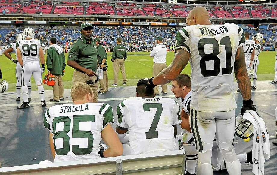 Jets quarterback Geno Smith (7) is consoled by tight end Kellen Winslow (81) late in the fourth quarter of the Jets' 38-13 loss to the Tennessee Titans Sunday. Photo: Mark Zaleski — The Associated Press  / FR170793 AP