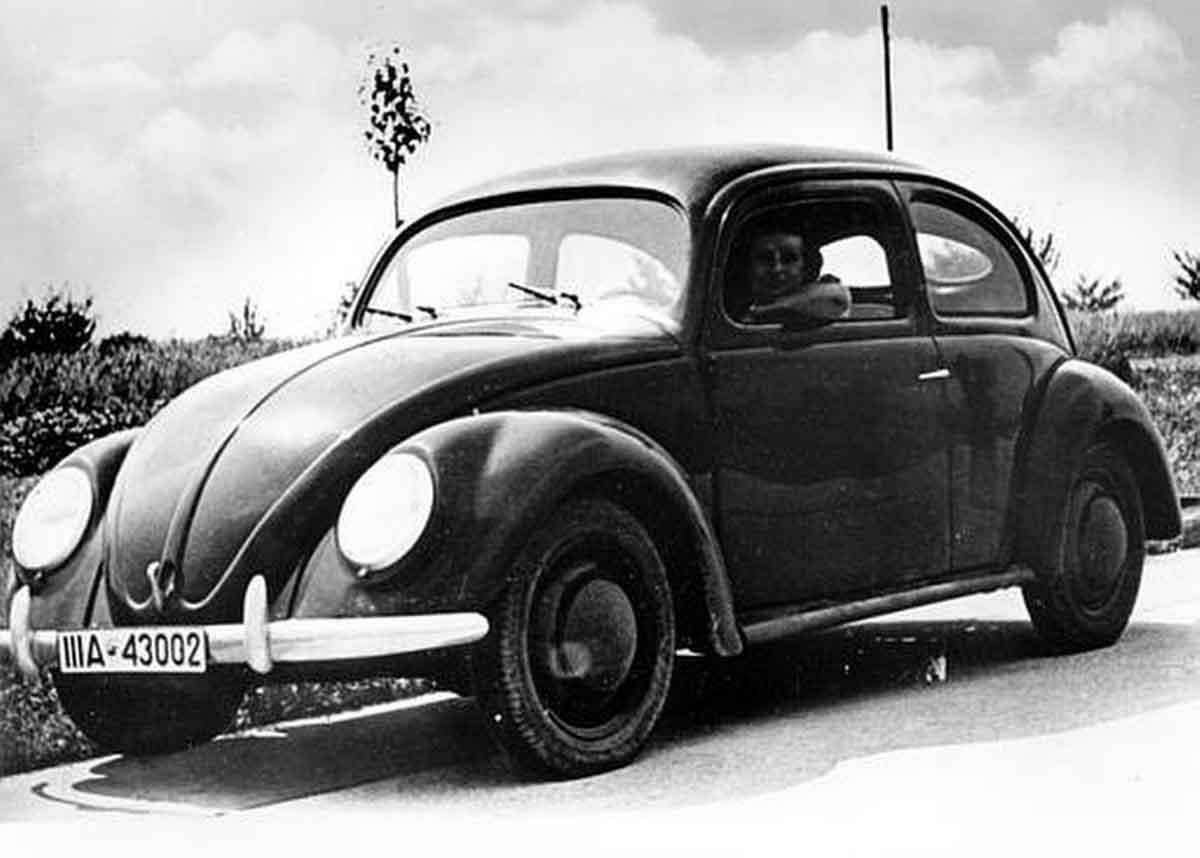 """This is a front view of a Volkswagen automobile in Germany in Aug. 1938. The people's car, also called """"Kraft durch Freudewagen,"""" Strength through Joy, is manufactured by the German Labor Front, a Nazi organization. The mass produced, low-priced car will cost 1000 deutsche marks, approximately $250 US. The model runs 35 miles on the gallon and 60,000 miles without the need of repairs. (AP Photo/German Railroads Information Office)"""