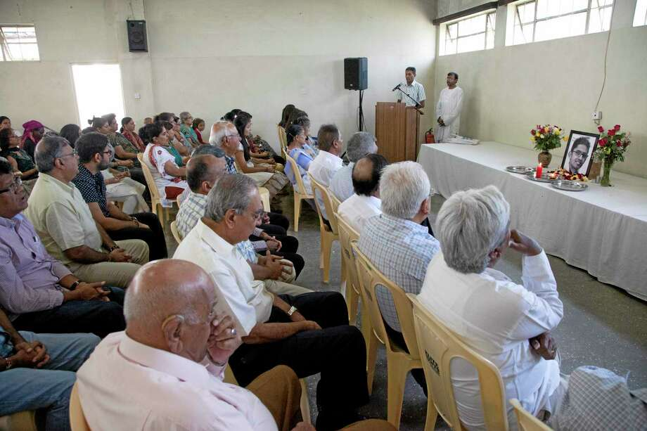 Friends and family members listen to a speaker during a prayer ceremony for 24 year old Rajan Lalitkumar Solanki, at Arya Samaj Temple in Nairobi, Kenya, Sunday, Sept. 29, 2013. Solanki was killed in the Westgate Mall attack. The masked gunmen who infiltrated Nairobi's Westgate mall arrived with a set of religious trivia questions: As terrified civilians hid, the assailants began a high-stakes game of 20 Questions to separate Muslims from those they consider infidels. (AP Photo/Sayyid Azim) Photo: AP / AP