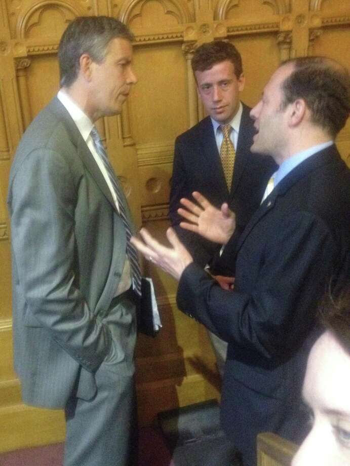 U.S. Education Secretary Arne Duncan (left) and state Rep. Matthew Lesser (D-Middletown) listen to House Education Committee Co-Chairman Andy Fleischmann (D-West Hartford) on Tuesday May 29. Duncan was in Hartford to laud Connecticut's groundbreaking new education reform legislation and to announce that Connecticut has been granted a waiver from the federal No Child Left Behind requirements.