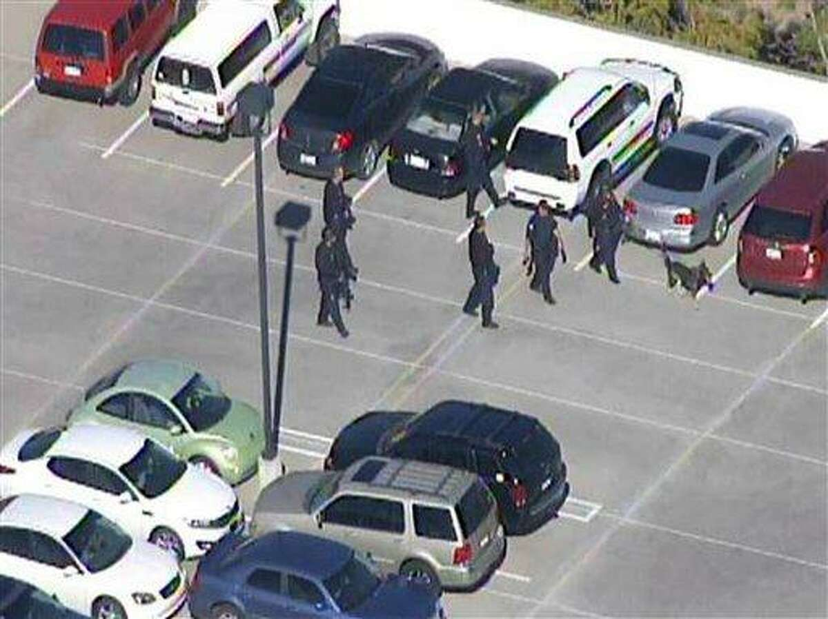 This frame grab provided by abc15.com shows the scene at a Phoenix office complex where police say a gunman shot at least three people on Wednesday, Jan. 30, 2013. Officer James Holmes said the victims were taken to hospitals and did not know if their injuries were life threatening. (AP Photo/abc15.com)
