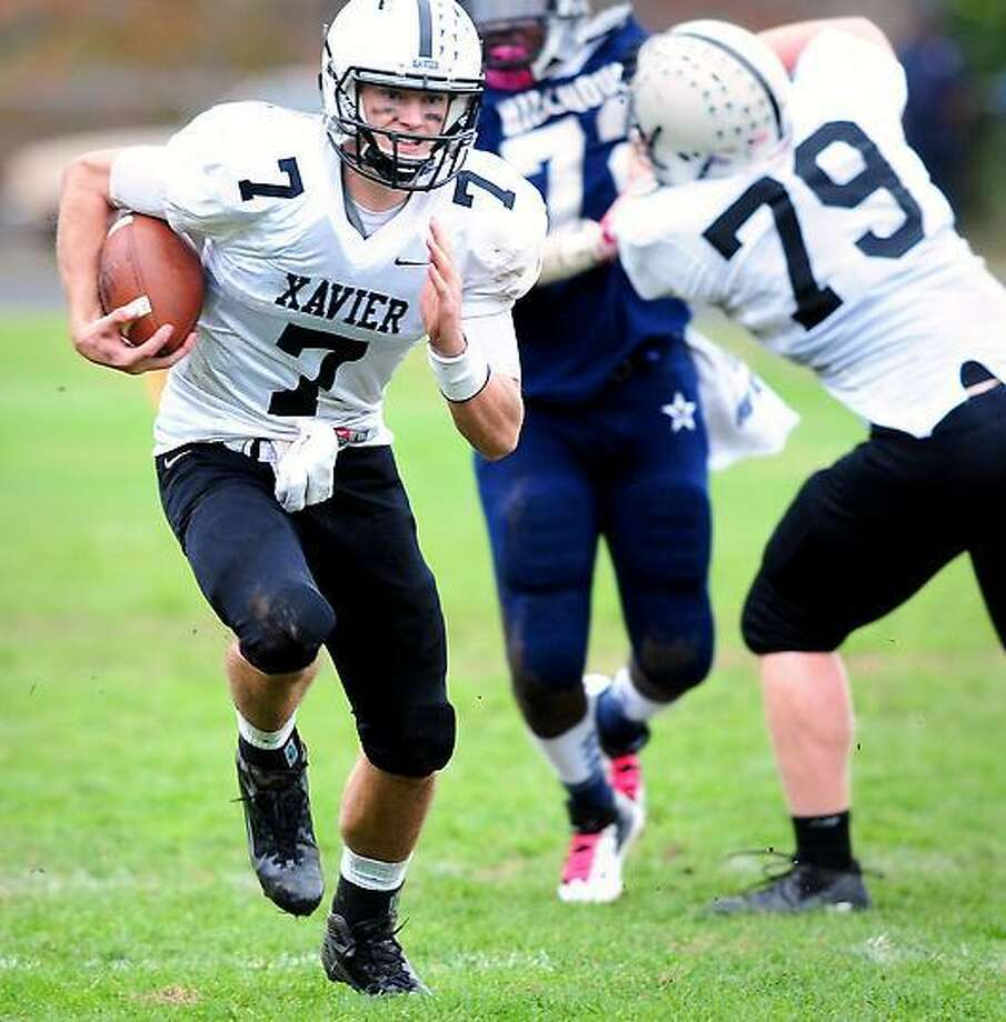 Xavier quarterback Tim Boyle (left) runs for a touchdown to put his team on the scoreboard against Hillhouse in the first half on 10/26/2012.Photo by Arnold Gold/New Haven Register
