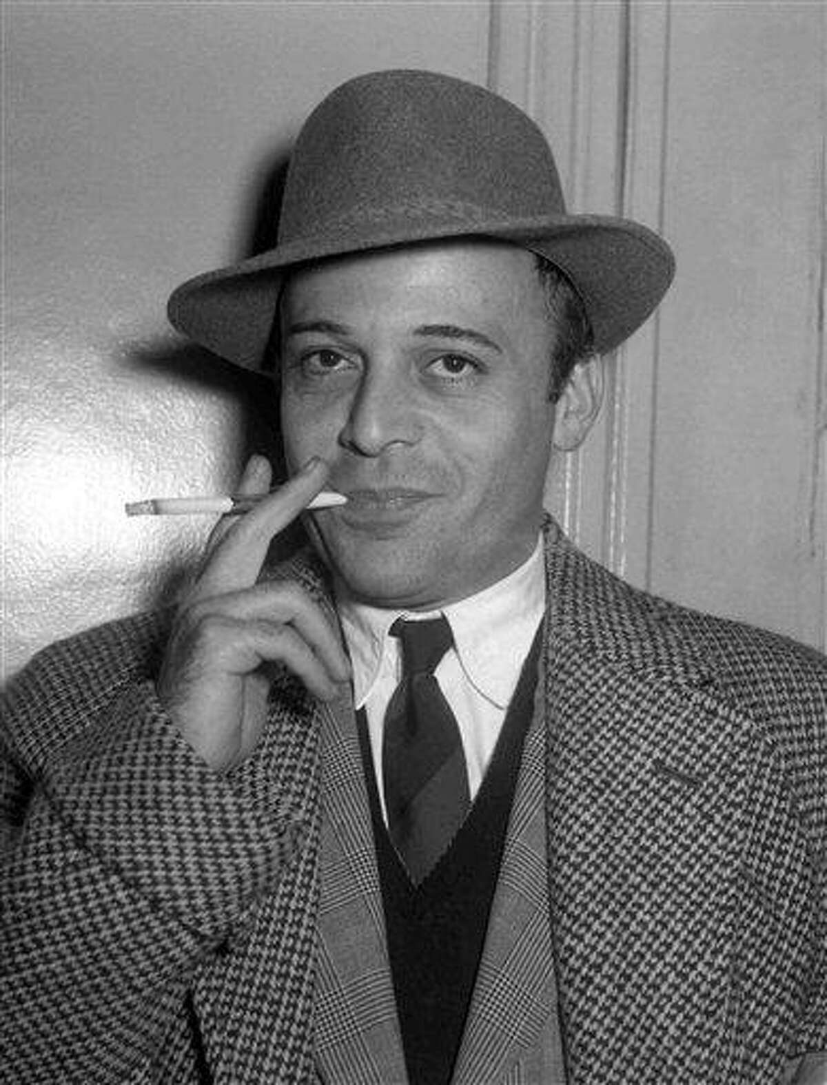 A 1955 file photo shows British actor Herbert Lom at London Airport prior to his departure to Rome, to continue filming 'War and Peace'. The Czech-born actor who starred as Inspector Clouseau's boss in the Pink Panther movies, has died. He was 95. Associated Press