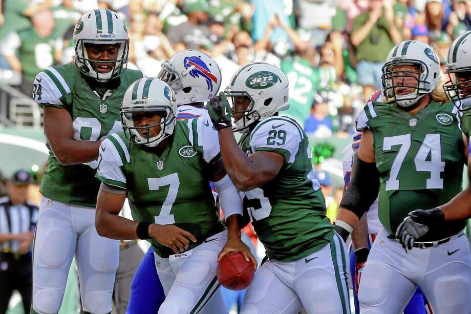 New York Jets quarterback Geno Smith (7) celebrates with teammates Bilal Powell (29) and Stephen Hill (84) after scoring a touchdown during Sunday's game against the Buffalo Bills in East Rutherford, N.J. Photo: Seth Wenig — The Associated Press  / AP