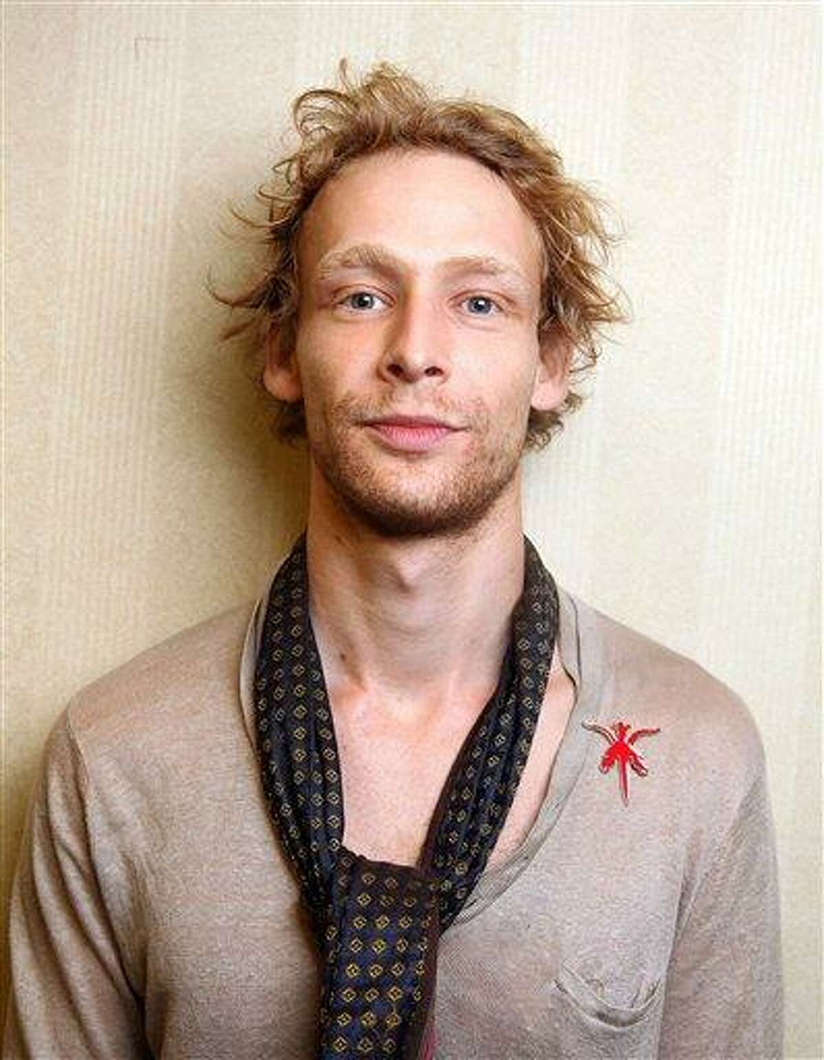 This 2011 file photo shows actor Johnny Lewis posing for a portrait during the 36th Toronto International Film Festival in Toronto, Canada. Authorities say Lewis fell to his death after killing an elderly Los Angeles woman. Lewis appeared in the FX television show