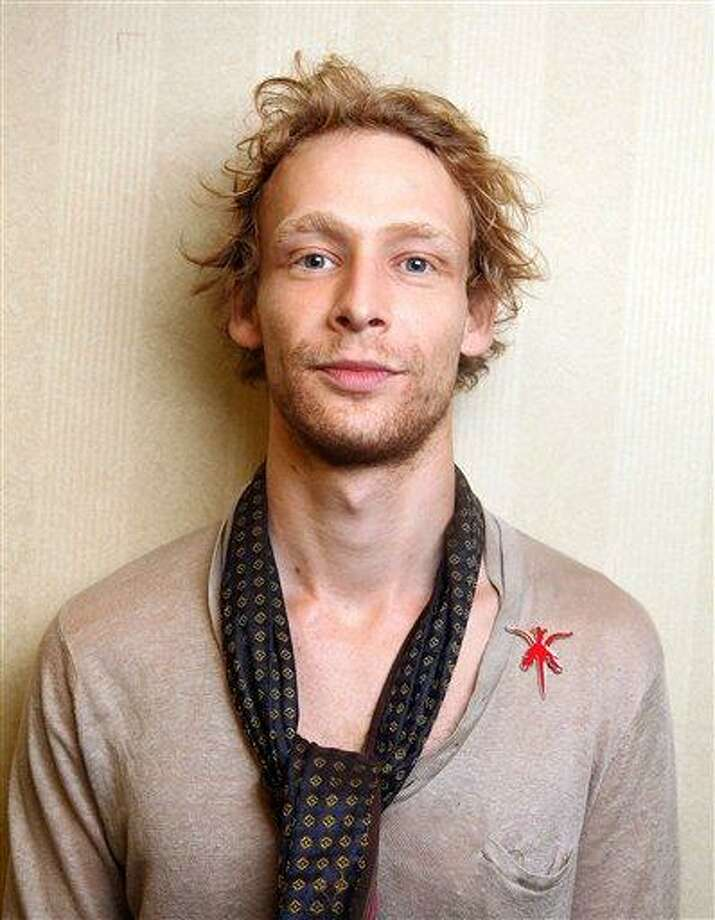 "This 2011 file photo shows actor Johnny Lewis posing for a portrait during the 36th Toronto International Film Festival in Toronto, Canada. Authorities say Lewis fell to his death after killing an elderly Los Angeles woman. Lewis appeared in the FX television show ""Sons of Anarchy"" for two seasons. Associated Press Photo: AP / R-Allegri"