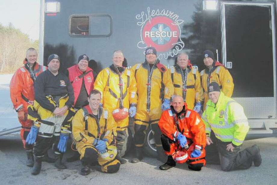 Submitted photo Haddam Firefighter Jay Selmer, highlighted, earned his Ice Rescue Instructor certification in 2012. Jay will teach a course on Feb. 9 for members of the volunteer fire company.