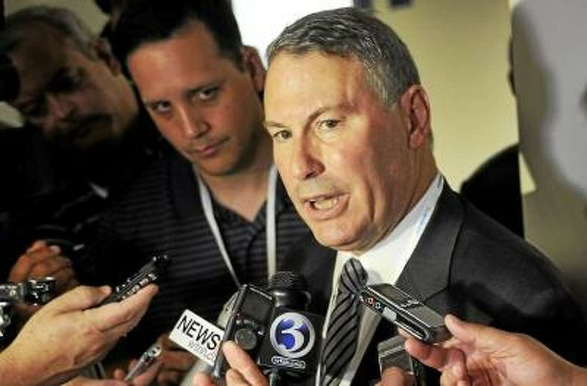 Former Big East commissioner and Middletown native Mike Aresco answers questions from the media before an NCAA college football game between Connecticut and Massachusetts at Rentschler Field in East Hartford last season. Photo by Jessica Hill/AP