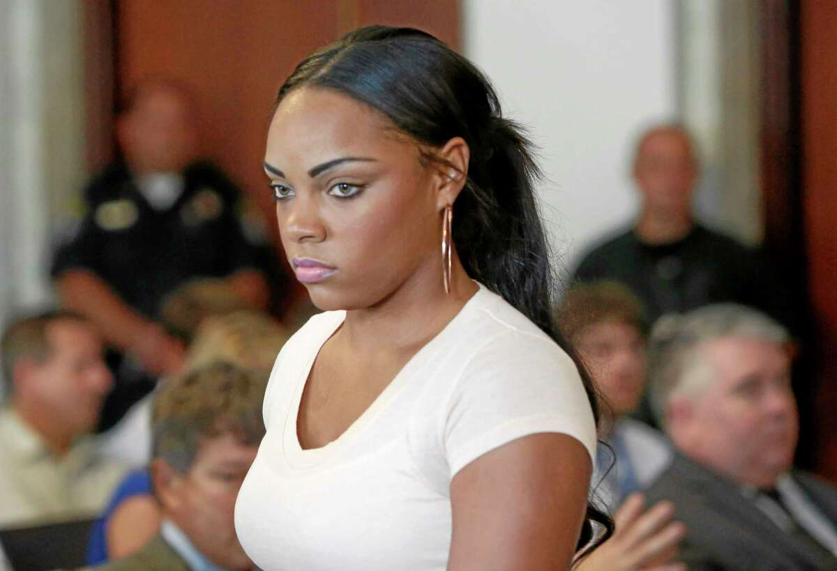 In this July 24, 2013, file photo, Shayanna Jenkins, fiancee of former New England Patriots NFL football player Aaron Hernandez, arrives at hearing for Hernandez at Attleboro District Courtroom in Attleboro, Mass. A Massachusetts prosecutor said Friday that a grand jury indicted Jenkins on a single count of perjury in relation to the investigation into the June 17 killing of Odin Lloyd. Lloyd had been dating Jenkins' sister. Hernandez has pleaded not guilty to first-degree murder in Lloyd's death and is being held without bail.