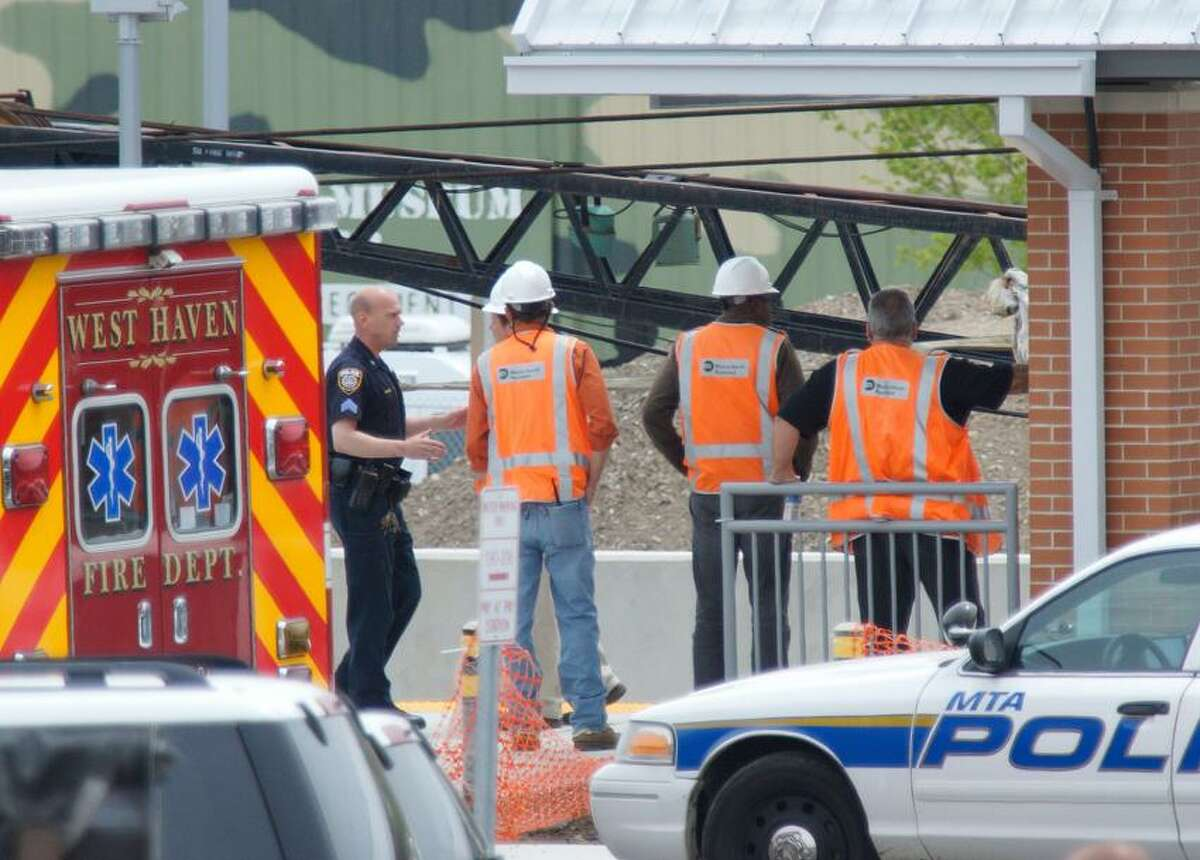 West Haven--West Haven and Metro North Police investigate the scene at the West Haven train station, where a worker was killed by a Metro North train, while working on the tracks. Photo-Peter Casolino/Register pcasolino@newhavenregister.com