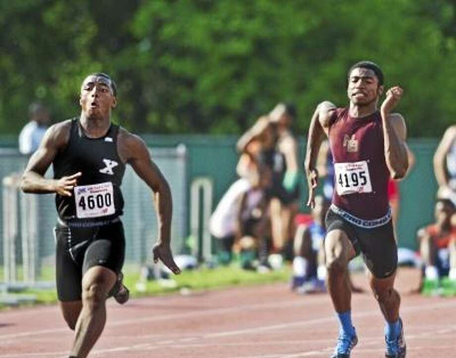 Xavier's DeAngelo Berry (left) competes in the 100 meter dash. Berry placed first in the 100 meter with a time of 10.85. Photo by Melanie Stengel/New Haven Register