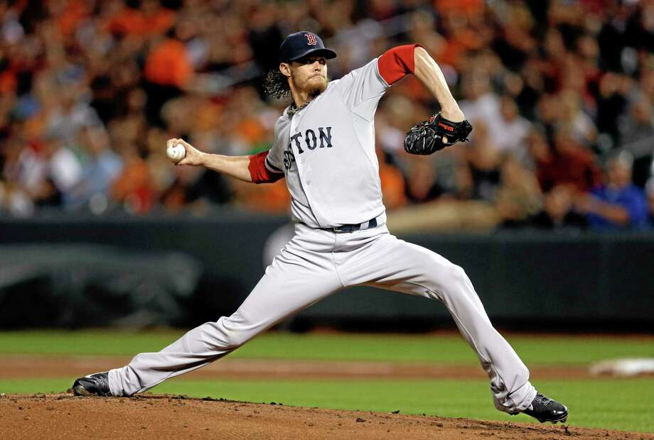 Clay Buchholz and the Boston Red Sox beat the Baltimore Orioles 12-3 on Friday night. Photo: Patrick Semansky — The Associated Press  / AP