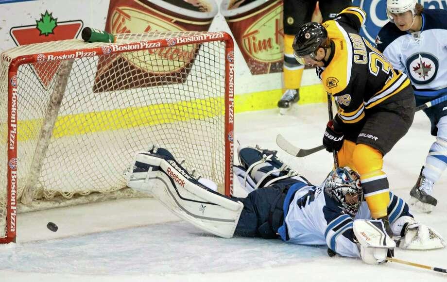 Bruins defenseman Zdeno Chara puts the puck past Winnipeg Jets goalie Al Montoya for a goal during the second period of a preseason game Friday in Saskatoon, Saskatchewan. Photo: Liam Richards — The Associated Press  / The Canadian Press