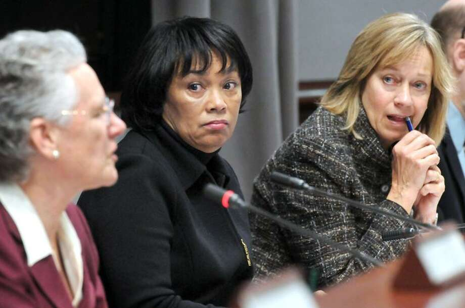 Legislative Office Building, Hartford; CT state legislature's Bipartisan Task Force Prevention and Children's Safety, Mental Health Services Working Group informational forum. Chair State Sen. Toni Harp center, co-chair, State Rep. Terrie Woods, right, listen to State Rep. Elizabeth Ritter ask a question, left. Mara Lavitt/New Haven Register1/29/13